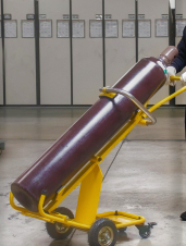 Worker moving gas cylinder